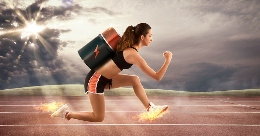Athletic Woman Running Fast with a Battery on her Back