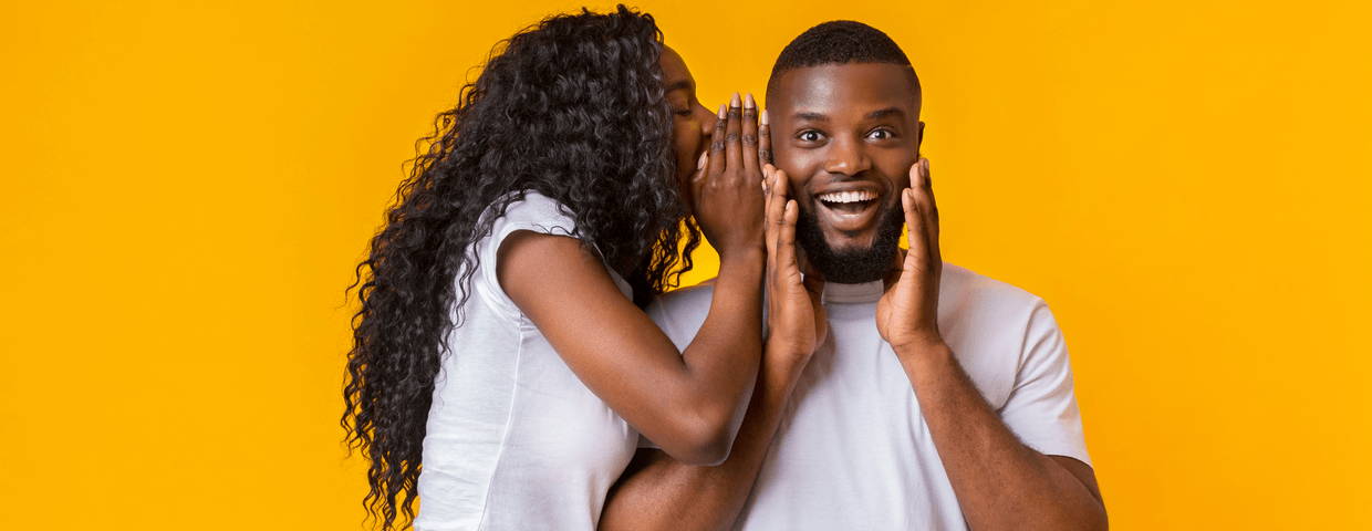 Woman Sharing Secret With Man, guy is excited, yellow background