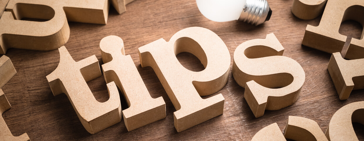 Wooden letters that spell out the word tips with a lightbulb above them