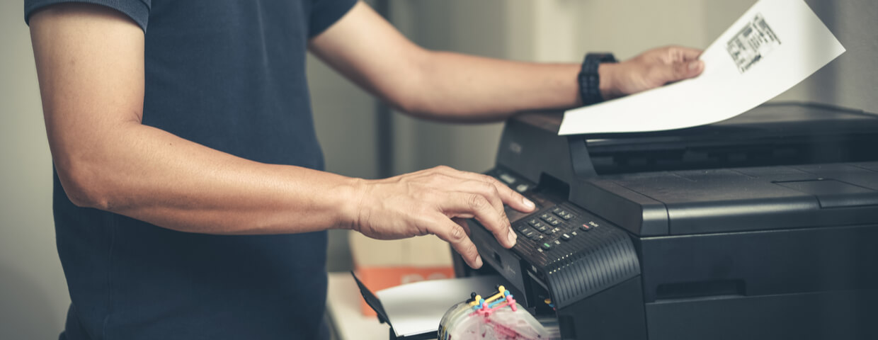 Man using printer in office